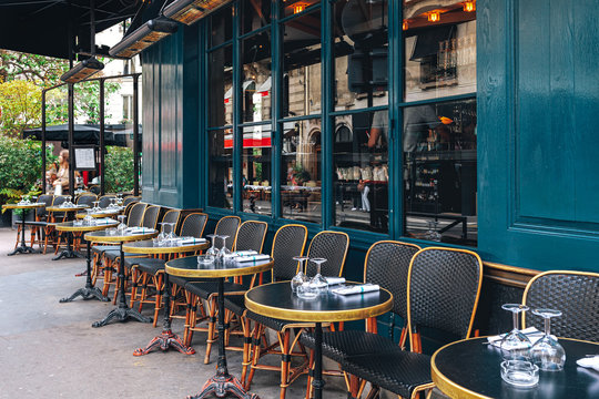 Tables and chairs in outdoor cafe in Paris, France.