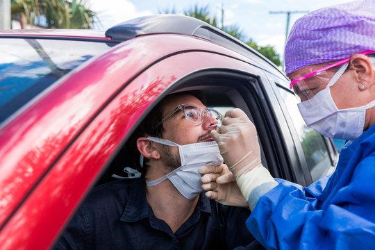 Doctor taking a nasal swab test