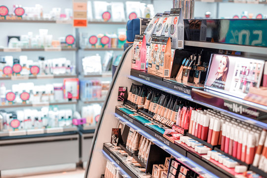 14 March 2020, Ufa, Russia: Maybelline makeup products and lipstick in cosmetic store department