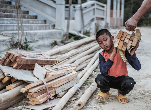 Children are forced to work in construction areas. Human rights concepts, December 10 Stop child abuse, violence, fear of child labor and human trafficking.