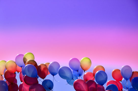 Colorful balloons in the sky stock images. Multicolored inflatable balloons stock images. Party balloons background with copy space for text. Party balloons frame. Rainbow balloons stock images