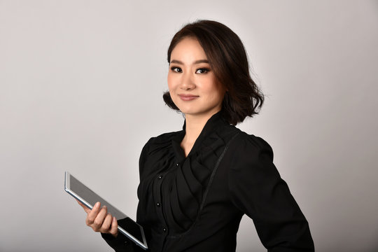 Confident business asian woman isolated in studio shot, Portrait of professional working people holding tablet computer with copy space.