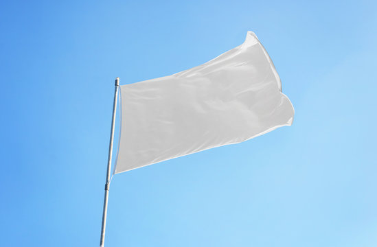White flag with clear sky in background. Flag mockup