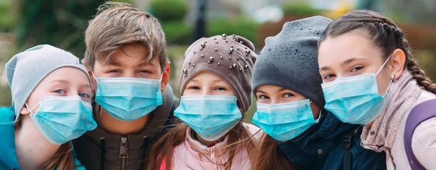 School-age children in medical masks. portrait of school children.