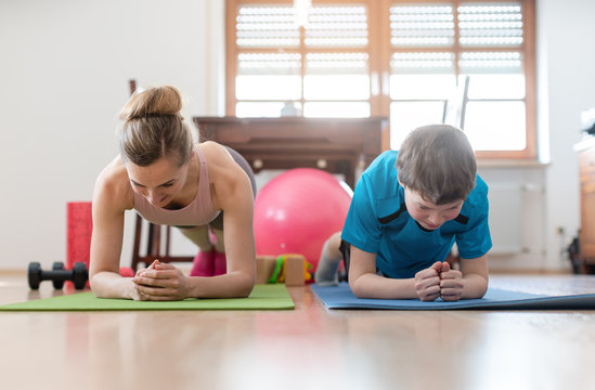 Family in self quarantine during Covid-19 crisis staying fit at home