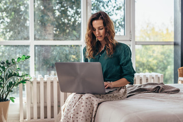 Woman using working on laptop and working from home
