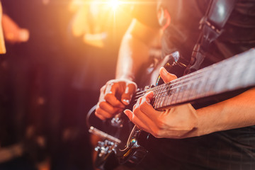 Guitarist play music song on stage.