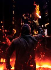 Protestant holding burning molotov cocktail.