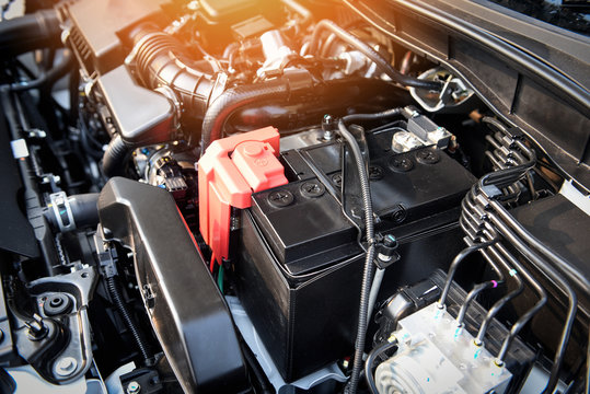 battery car engine detail motor - close up of machine new batteries car engine checking car battery cleaning for deliver customers in the car service