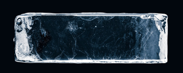 Ice block, on white surface, isolated on black background. Clipping path included.