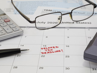 A 2020 calendar noting the USA Internal Revenue Service IRS income tax filing deadline has been moved to July 15 rather than April 15, due to the COVID-19 coronavirus pandemic, is shown up close.
