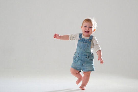10 month old little baby learning to walk..Studio photography