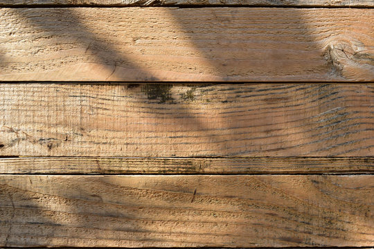 wood barn wall plank texture background with light and shadow in the morning day, top view of old wooden table