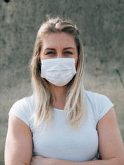 young woman in medical mask during coronavirus disease,  covid-19