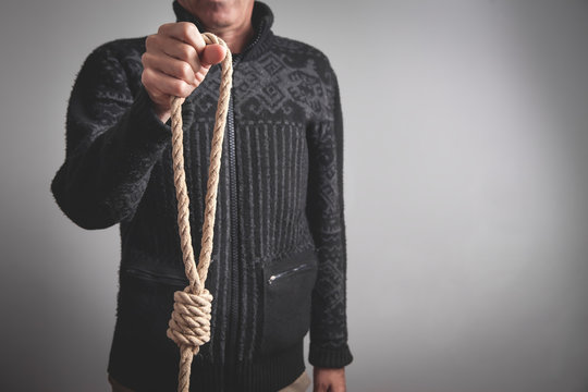 Man holding rope loop. Suicide concept