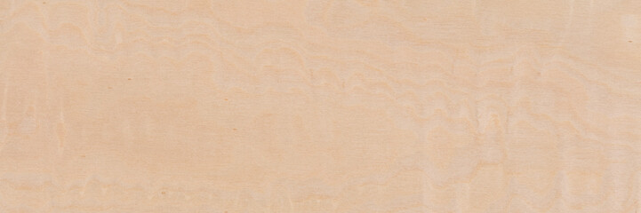 New light beige maple veneer background as part of your design. Long plank texture. Wooden pattern.