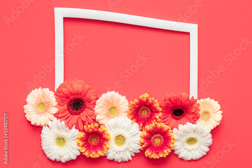 Happy Mother's Day, Women's Day, Valentine's Day or Birthday Living Coral Lush Lava Background. Floral flat lay greeting card template with beautiful gerberas.