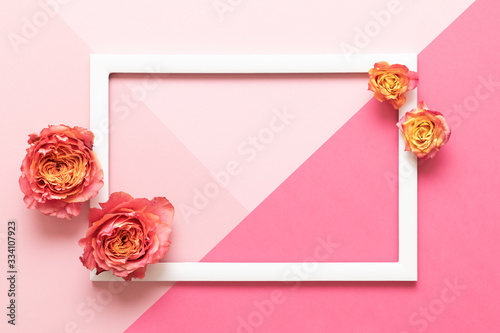 Happy Mother's Day, Women's Day, Valentine's Day or Birthday Pastel Pink Colored Background.  Floral flat lay mock up greeting card with beautiful roses.