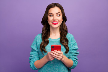 Photo of pretty lady hold telephone youth popular blogger look wondered side empty space red...