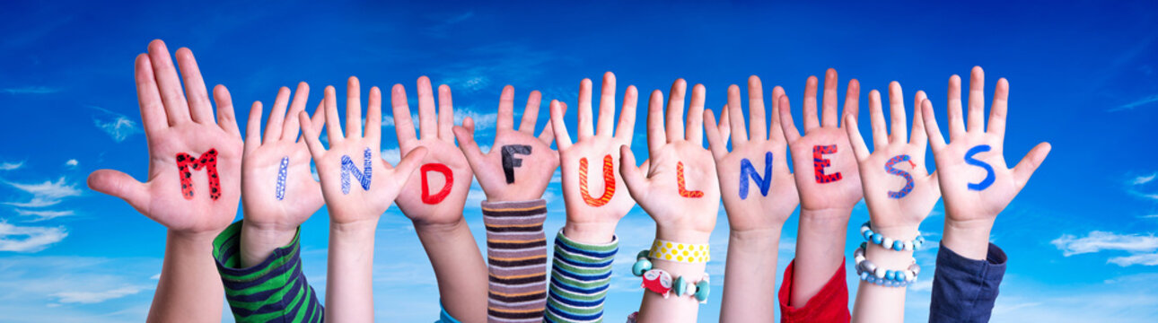 Children Hands Building Colorful English Word Mindfulness. Blue Sky As Background