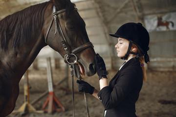 Foto op Plexiglas Woman near horse. Rider in a black uniform