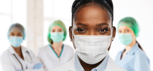 health, medicine and pandemic concept - close up of african american female doctor or scientist in...