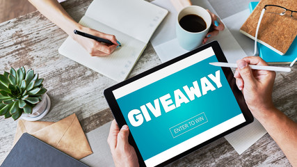 Giveaway, enter to win text on screen. Lottery and prizes. Social media marketing and advertising...