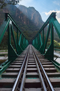 Green railway bridge along the Salkantay Trek near Aguas Calientes, Peru