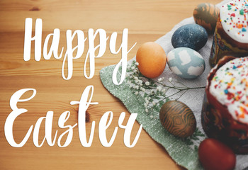 Happy Easter text. Easter greetings lettering. Stylish easter eggs natural dyed and homemade easter...