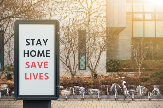 """Street banner with the inscription """"Stay home save lives"""". Quarantine self-isolation"""