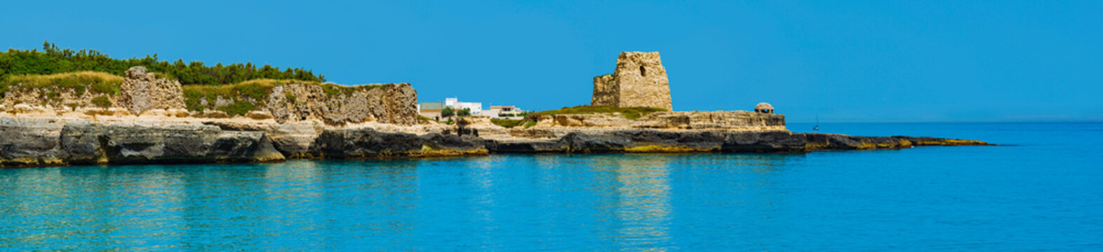 Holiday in Apulia. The important archaeological site and tourist resort of Roca Vecchia, in Puglia, Salento, Italy. In the background, an anti-aircraft casemate from World War II