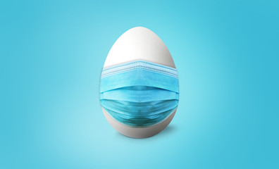 White easter egg with blue mask on blue backgroung