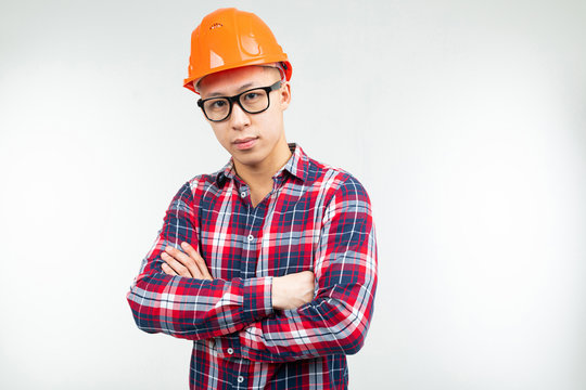 man in glasses an orange helmet of the builder on a white background