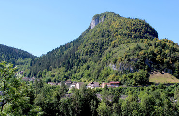 View of the picturesque town of Sainte Claude and surrounding scenery in the Haut Jura region of France. St. Claude is the largest town in the region.