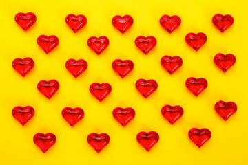 Diagonal pattern of red hearts on yellow background