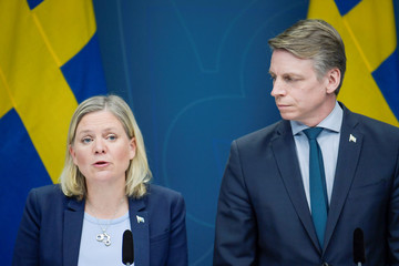 Swedish Finance Minister Magdalena Andersson and Minister for Financial Markets and Housing Per Bolund speak during a news conference in Stockholm