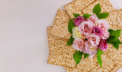 Jewish matzah bread with roses. Jewish Passover holiday concept.