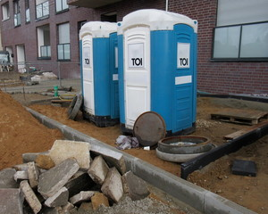 Mobile toilets cabins, dixie closet. WC Toilets for construction workers on a construction site in front of a building