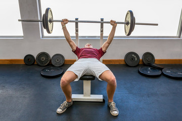Young dutch man bench press with barbell