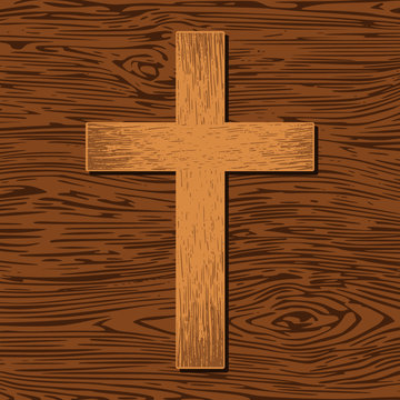 Wooden cross on wooden background