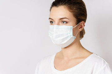 Young woman is wearing a face mask for protection against virus