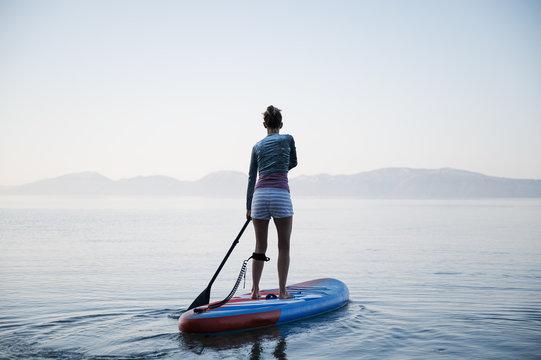 Woman paddling on sup board