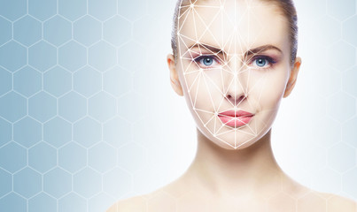 Face of a beautifyl girl with a scanning grid on her face. Face id, security, facial recognition, authentication technology.