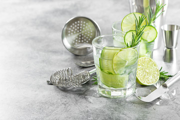Bar accessories cocktail drink cucumber lime rosemary ice Wall mural