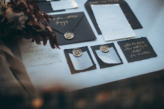 01.06.2019 Tbilisi, Georgia: stylish wedding invitations made of crafty vintage retro style laid out near a window with early light