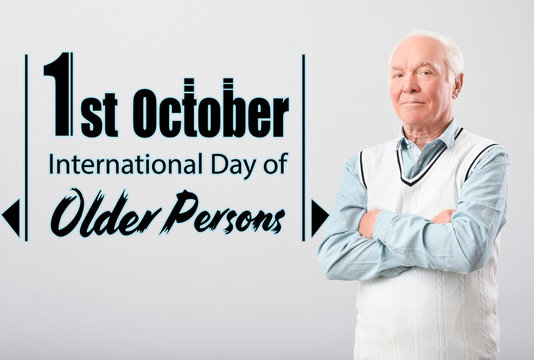 Portrait of elderly man on grey background. International day of older persons
