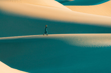 Woman walking in the sand dunes