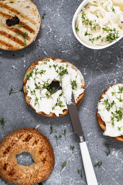 A bagel with cream cheese and microgreen