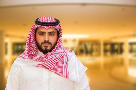 Arabian (Gulf area) smiling man with traditional wear.