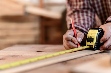 Carpenter working and DIY woodwork at home.  Social Distancing.